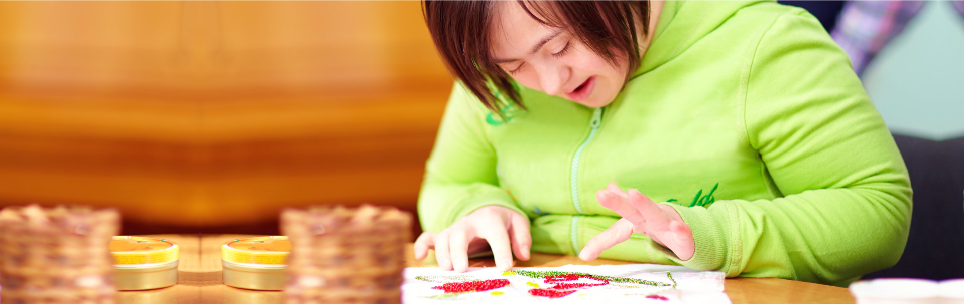 little girl making artwork